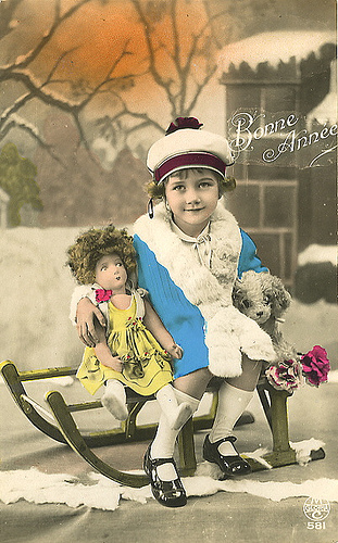 Girl_with_doll_postcard